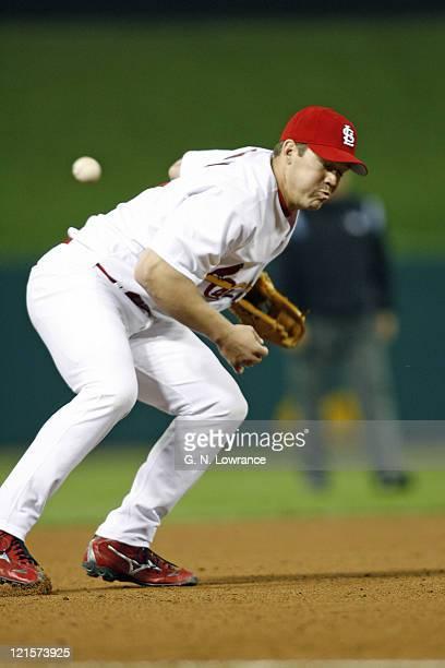 Third baseman Scott Rolen of the Cardinals commits an error during action between the Arizona Diamondbacks and St Louis Cardinals at Busch Stadium in...
