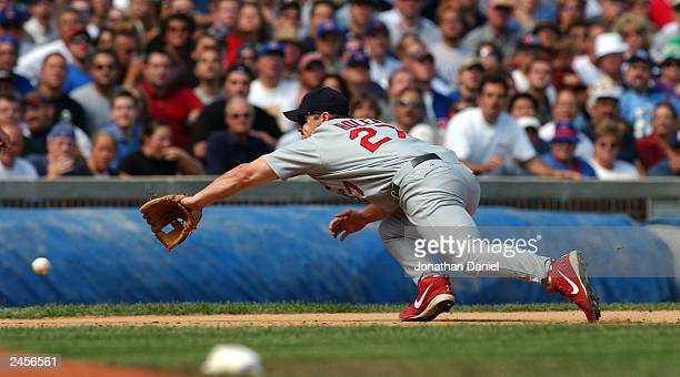 Third baseman Scott Rolen of the St Louis Cardinals dives in an unsuccessful attempt to snag a grounder hit by catcher Damian Miller of the Chicago...