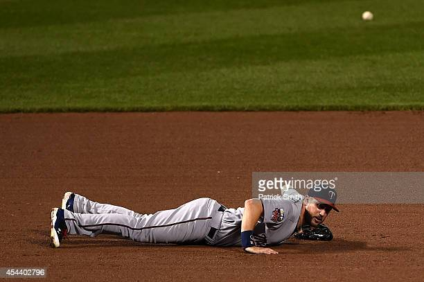 Third baseman Trevor Plouffe of the Minnesota Twins misses a hit by JJ Hardy of the Baltimore Orioles in the fourth inning at Oriole Park at Camden...