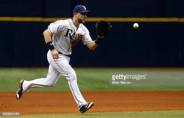 Third baseman Trevor Plouffe of the Tampa Bay Rays fields the ground out by Mitch Haniger of the Seattle Mariners to end the top of the sixth inning...