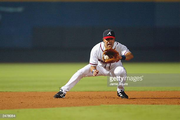 Third baseman Vinny Castilla of the Atlanta Braves catches a line drive during the 9th inning against the New York Mets August 27, 2003 at Turner...