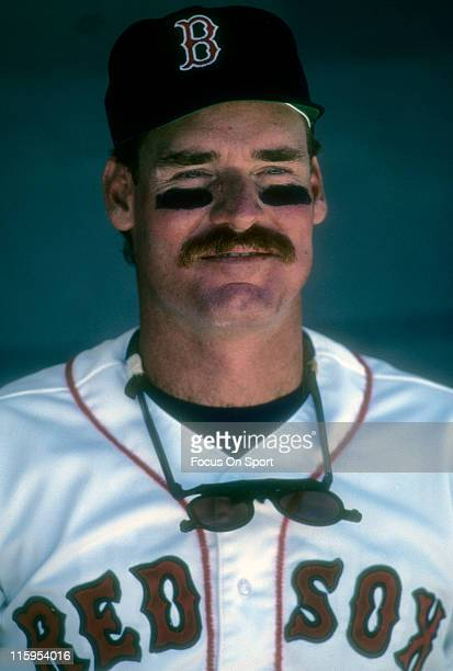 Third Baseman Wade Boggs of the Boston Red Sox looks on from the dugout before a Major League Baseball game circa 1986 at Fenway Park in Boston...