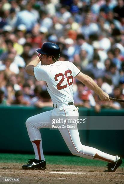 Third Baseman Wade Boggs of the Boston Red Sox swings and watches the flght of his ball during a Major League Baseball game circa 1986 at Fenway Park...