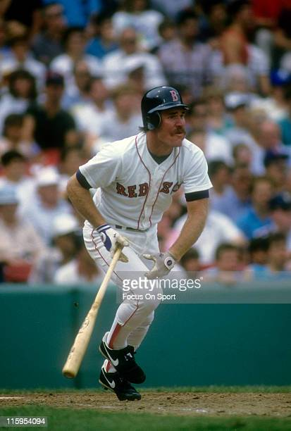 Third Baseman Wade Boggs of the Boston Red Sox swings and watches the flight of his ball during a Major League Baseball game circa 1986 at Fenway...