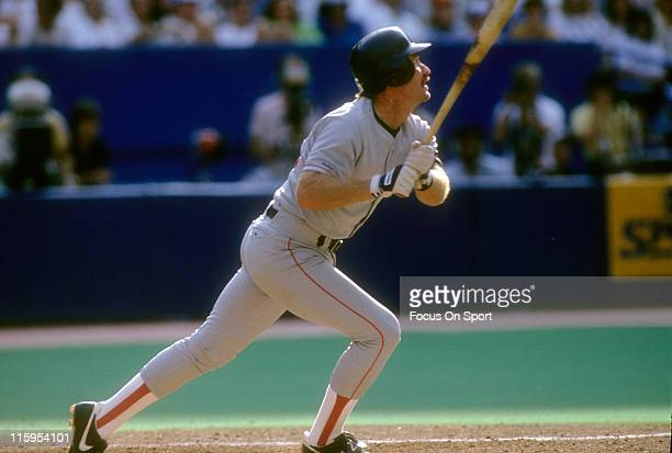 Third Baseman Wade Boggs of the Boston Red Sox swings and watches the flight of his ball during a Major League Baseball game circa 1991 Boggs played...