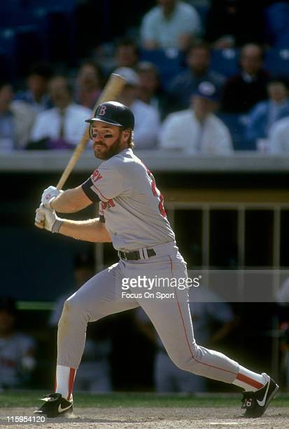 Third Baseman Wade Boggs of the Boston Red Sox swings and watches the flight of his ball against the Chicago White Sox during a Major League Baseball...