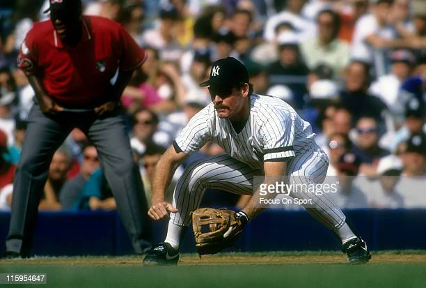 Third Baseman Wade Boggs of the New York Yankees is down and ready to make a play on the ball during a Major League Baseball game circa 1996 at...