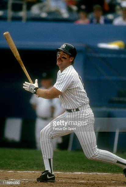 Third Baseman Wade Boggs of the New York Yankees swings and watches the flight of his ball during a spring training Major League Baseball game circa...