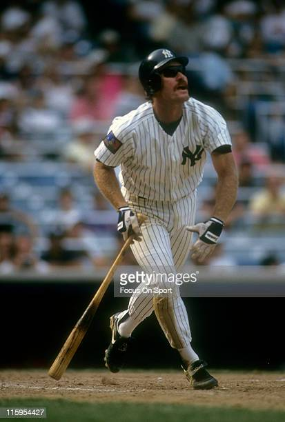 Third Baseman Wade Boggs of the New York Yankees swings and watches the flight of his ball during a Major League Baseball game circa 1994 at Yankee...