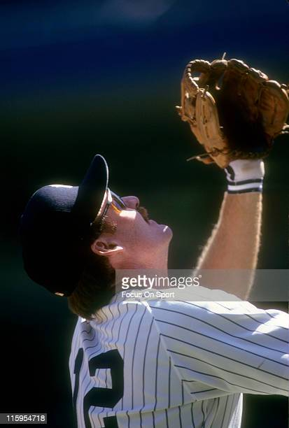 Third Baseman Wade Boggs of the New York Yankees tracks a popup on the infield during a Major League Baseball game circa 1993 at Yankee Stadium in...