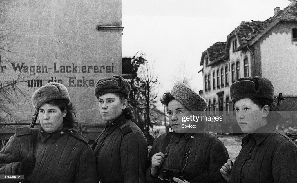 Third belorussian front, world war 2, a group of young women, red army snipers who have 2,000 german kills between them, inspecting a small town in east prussia that has been taken by the soviet army, february 1945. : News Photo
