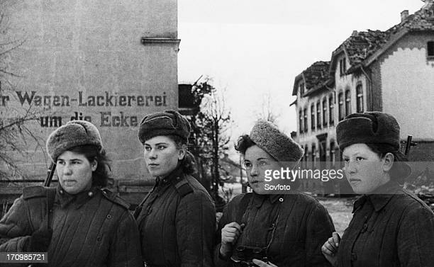 Third belorussian front world war 2 a group of young women red army snipers who have 2000 german kills between them inspecting a small town in east...