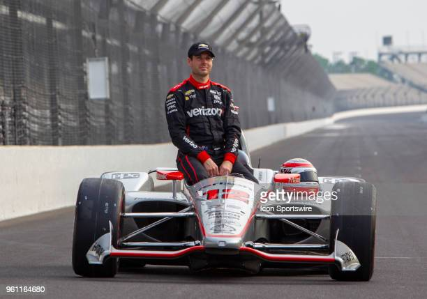 Third fastest qualifier Will Power driver of the Verizon Team Penske Chevrolet sits in his car during the early morning Front Row photo session for...
