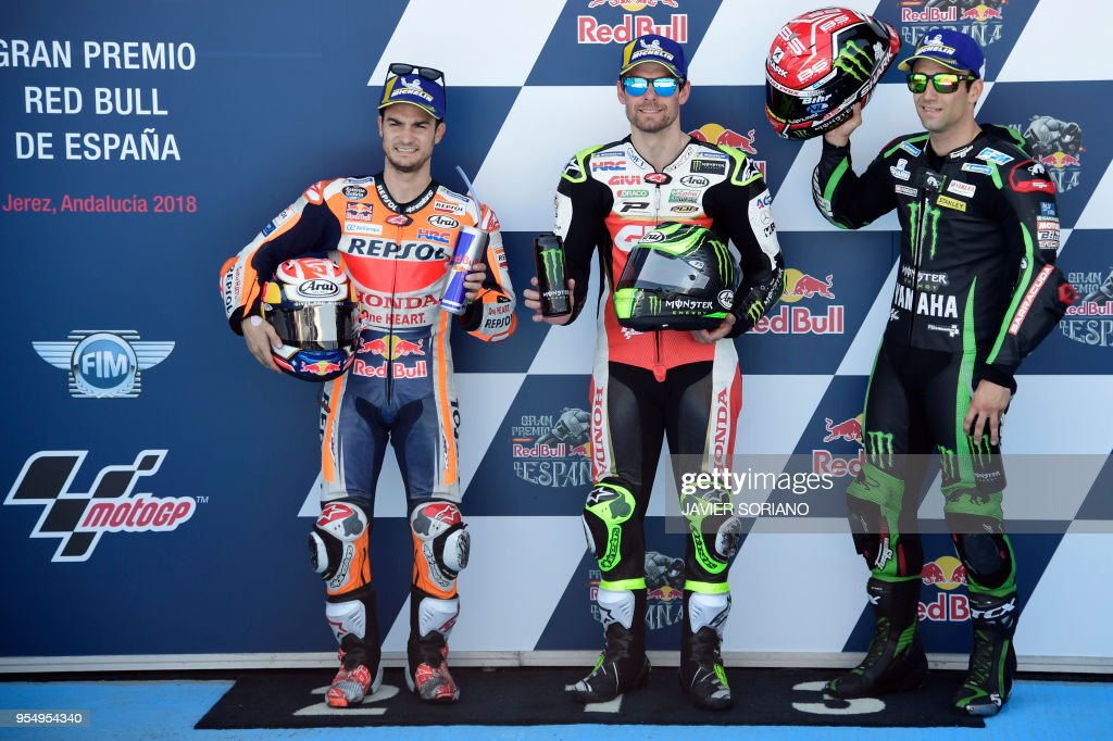 Third, first and second placed competitors, Monster Yamaha Tech 3's French rider Johann Zarco, LCR Honda's British rider Cal Crutchlow and Repsol Honda Team's Spanish rider Dani Pedrosa pose after the MotoGP qualifying session of the Spanish Grand Prix at the Jerez racetrack in Jerez de la Frontera on May 5, 2018.
