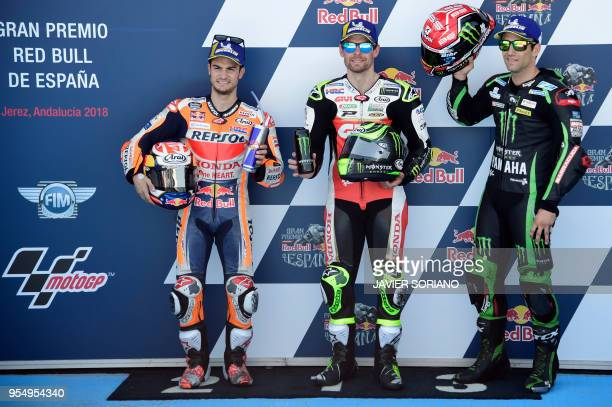 Third first and second placed competitors Monster Yamaha Tech 3's French rider Johann Zarco LCR Honda's British rider Cal Crutchlow and Repsol Honda...