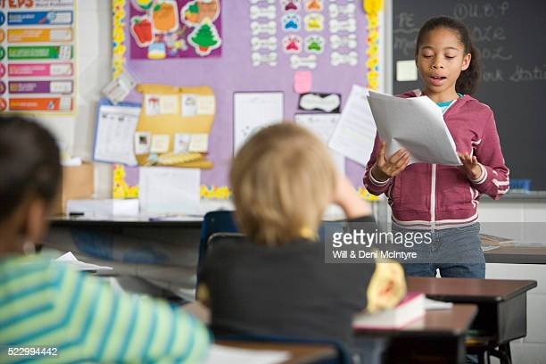 third grade girl giving report to class - candidate stock pictures, royalty-free photos & images