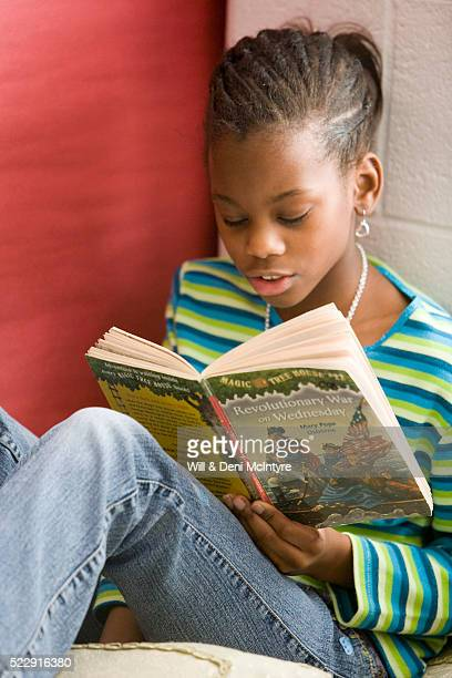 Third Grade Girl Reading in History Class