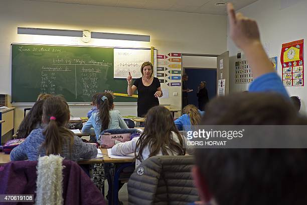 Third grade primary school pupils at the Hamaskaine Armenian school sit during their Armenian language class on April 21 in Marseille southern France...