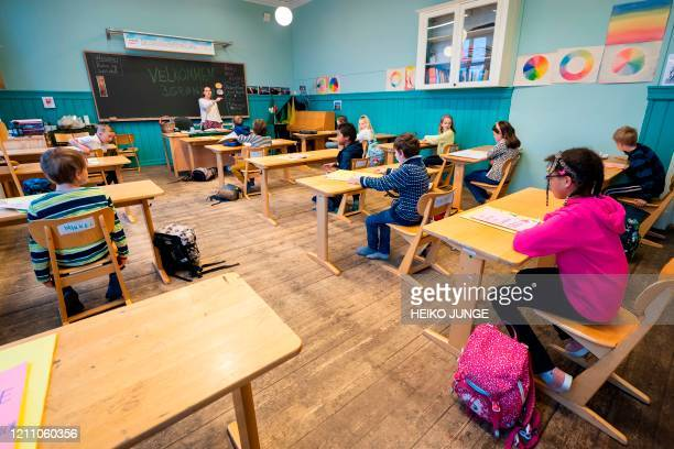 Third grade pupils at Nordstrand Steinerskole school in Oslo attend a lesson in their classroom after the school reopened on April 27 amid the novel...