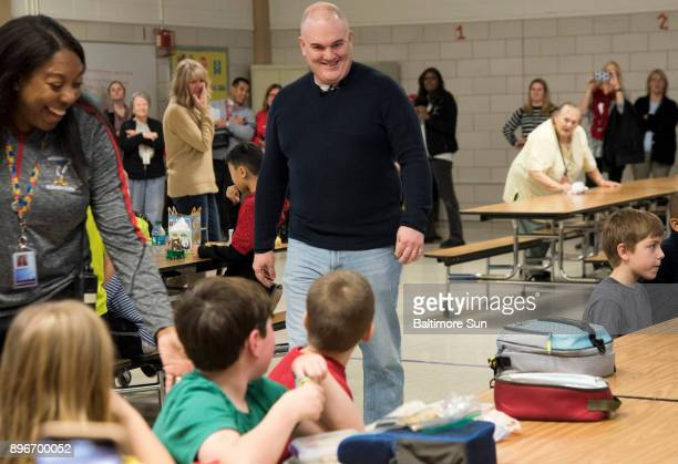 Third grader at Millersville Elementary School Ebin Pardue turns from his lunch table to see his father Thomas Pardue walking toward him for a...
