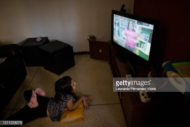 """Third grader Camila Fernandez watches the new Educational channel """"Vive Tv"""" on her home television during the second month of quarantine in the..."""
