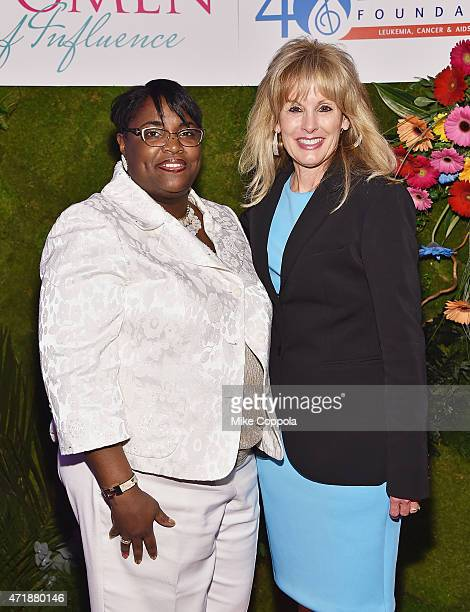 Third highest ranking officer in New York Citys Transit Union Local 100 LaTonya CrispSauray and CEO TJ Martell Foundation Laura Heatherly attend the...