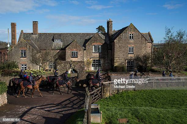 Third lot head past the home of trainer Philip Hobbs built in 1588 on January 18 2016 at Sandhill Racing stables in Minehead England Sandhill Racing...