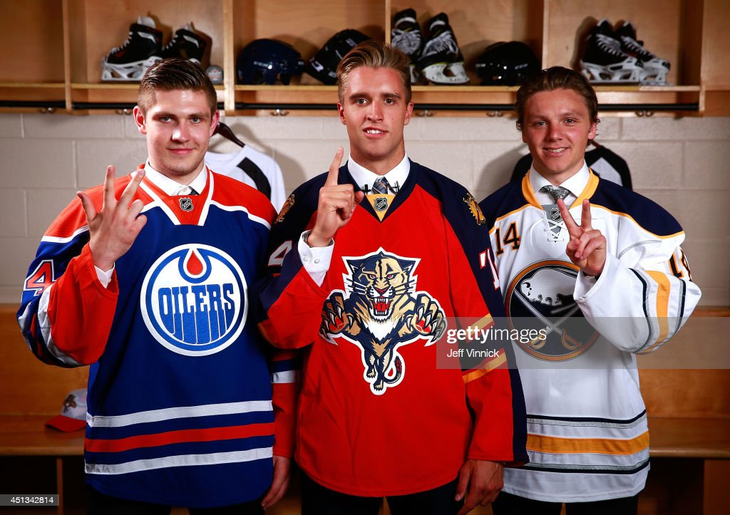 Third overall pick Leon Draisaitl of the Edmonton Oilers, first overall pick Aaron Ekblad of the Florida Panthers and second overall pick Sam Reinhart of the Buffalo Sabres pose for a portrait during the 2014 NHL Entry Draft at Wells Fargo Center on June 27, 2014 in Philadelphia, Pennsylvania.