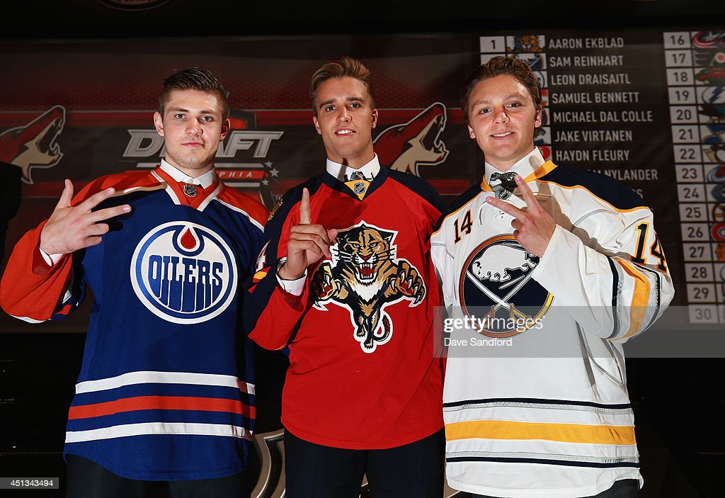 Third overall pick Leon Draisaitl of the Edmonton Oilers, first overall pick Aaron Ekblad of the Florida Panthers and second overall pick Sam Reinhart of the Buffalo Sabres pose together during the 2014 NHL Entry Draft at Wells Fargo Center on June 27, 2014 in Philadelphia, Pennsylvania.
