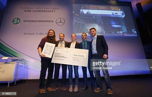 Third place award winner Internationaler Bund Jugendhaus One Pirmasens poses during the DFB & Mercedes Benz Integration Prize Award Gala at German...