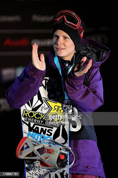 Third place Cheryl Maas of the Netherlands poses on the podium after the FIS Snowboard Slopestyle World Cup Finals during day five of the Winter...