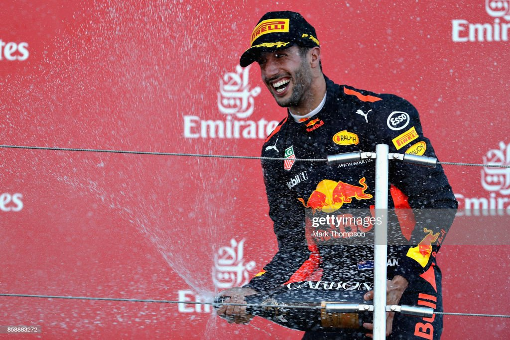 Third place finisher Daniel Ricciardo of Australia and Red Bull Racing celebrates on the podium during the Formula One Grand Prix of Japan at Suzuka Circuit on October 8, 2017 in Suzuka.