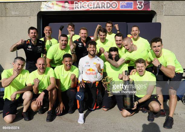 Third place finisher Daniel Ricciardo of Australia and Red Bull Racing celebrates with his team during the Canadian Formula One Grand Prix at Circuit...