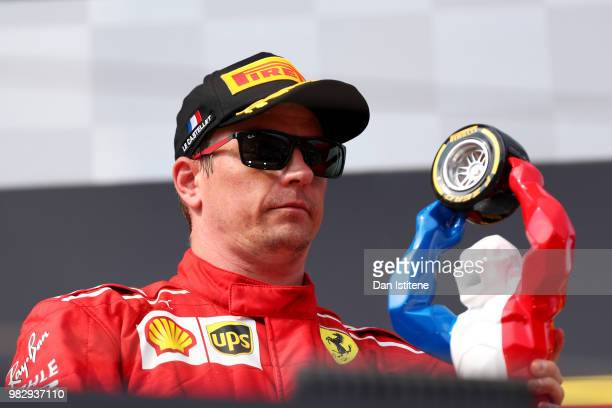 Third place finisher Kimi Raikkonen of Finland and Ferrari celebrates on the podium during the Formula One Grand Prix of France at Circuit Paul...