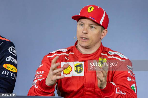 Third place finisher Kimi Raikkonen of Finland and Ferrari speaks in the post race press conference after Formula One Grand Prix of China at Shanghai...