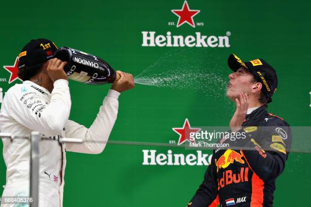 Third place finisher Max Verstappen of Netherlands and Red Bull Racing and race winner Lewis Hamilton of Great Britain and Mercedes GP celebrate on...