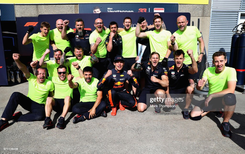 Third place finisher Max Verstappen of Netherlands and Red Bull Racing celebrates with his team after the Canadian Formula One Grand Prix at Circuit Gilles Villeneuve on June 10, 2018 in Montreal, Canada.