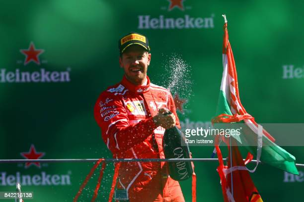 Third place finisher Sebastian Vettel of Germany and Ferrari celebrates on the podium during the Formula One Grand Prix of Italy at Autodromo di...