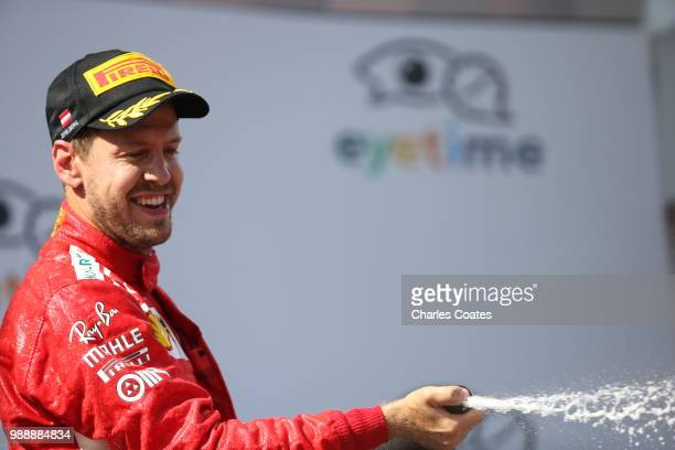 Third place finisher Sebastian Vettel of Germany and Ferrari celebrates on the podium during the Formula One Grand Prix of Austria at Red Bull Ring...