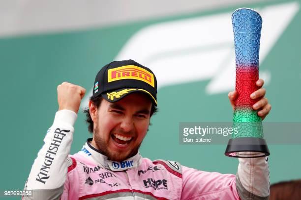 Third place finisher Sergio Perez of Mexico and Force India celebrates on the podium during the Azerbaijan Formula One Grand Prix at Baku City...