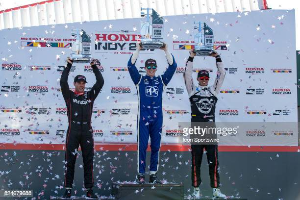 Third place finisher Will Power of Australia driver of the Chevrolet IndyCar for Team Penske winner Josef Newgarden of the United States driver of...
