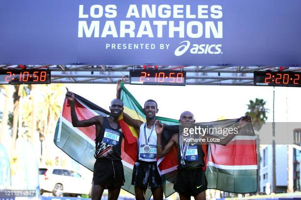 Third place finisher Wilson Kwambai Chebet of Kenya winner Bayelign Teshager of Ethiopia and second place finisher John Langat of Kenya pose at the...