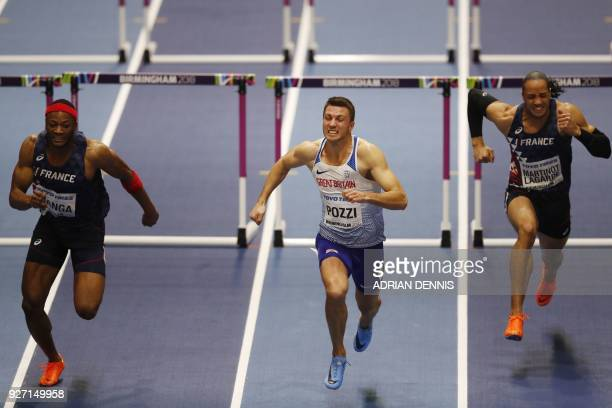 Third place France's Aurel Manga winner Britain's Andrew Pozzi and France's Pascal MartinotLagarde compete in the men's 60m hurdles final at the 2018...