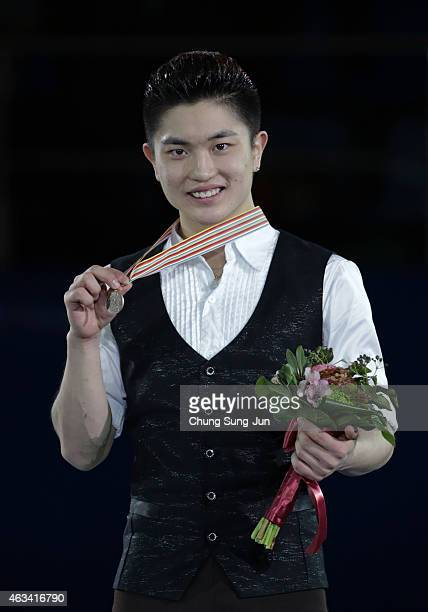 Third place Han Yan of China poses on the podium after the medals ceremony of the Men Skating on day three of the ISU Four Continents Figure Skating...