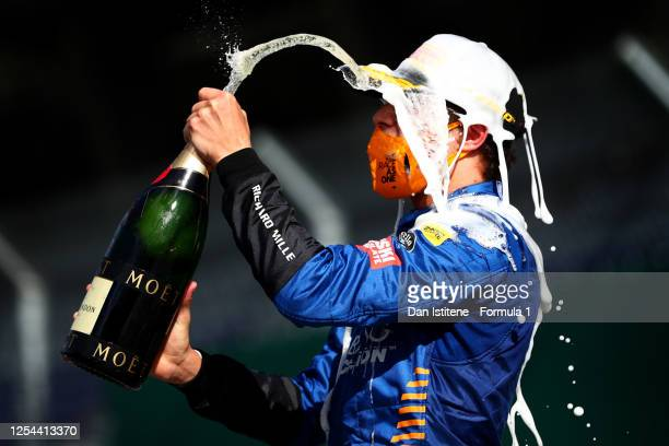 Third place Lando Norris of Great Britain and McLaren F1 celebrates on the podium during the Formula One Grand Prix of Austria at Red Bull Ring on...