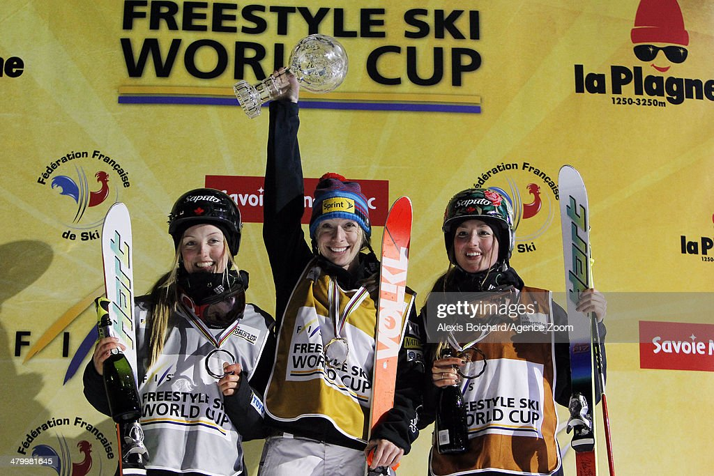 Third place Maxime Dufour-Lapointe of Canada, first place Hannah Kearney of the USA with the Overall Freestyle World Cup globe and second place winner Chloe Dufour-Lapointe of Canada during the FIS Freestyle Ski World Cup Men's and Women's Dual Moguls on March 21, 2014 in La Plagne, France.