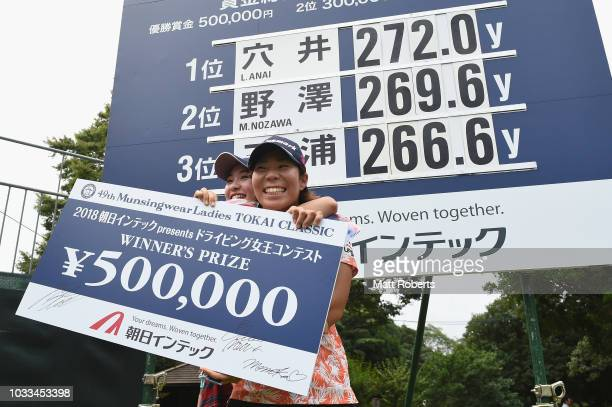 Third place Momoka Miura and first place Lala Anai of Japan celebrate during the presentation of longest drive contest after the second round of the...