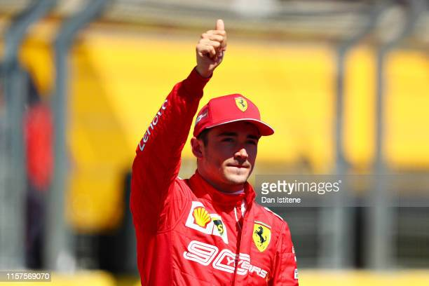 Third place qualifier Charles Leclerc of Monaco and Ferrari celebrates in parc ferme during qualifying for the F1 Grand Prix of France at Circuit...