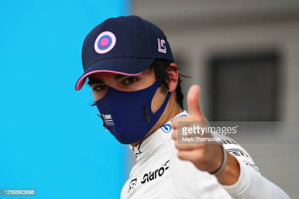 Third place qualifier Lance Stroll of Canada and Racing Point celebrates in parc ferme during qualifying for the F1 Grand Prix of Hungary at...