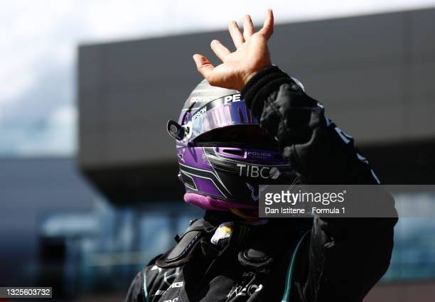 Third place qualifier Lewis Hamilton of Great Britain and Mercedes GP waves to the crowd from parc ferme during qualifying ahead of the F1 Grand Prix...